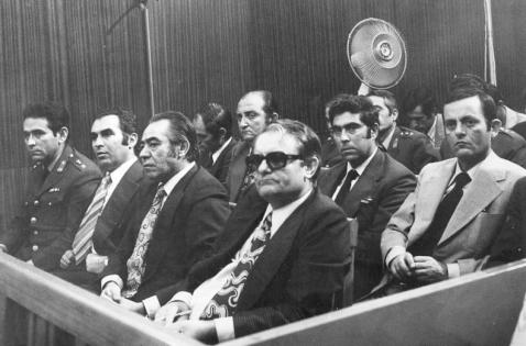 Η δίκη τών χουντικών διακρίνεται ο αρχιβασανιστής Θεοφιλογιαννάκος