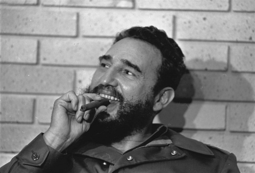 Cuban Prime Minister Fidel Castro with cigar during his meeting with U.S. senators Javits and Pell during their meeting in Havana, Cuba, September 29, 1974. (AP Photo/Charles Tasnadi)